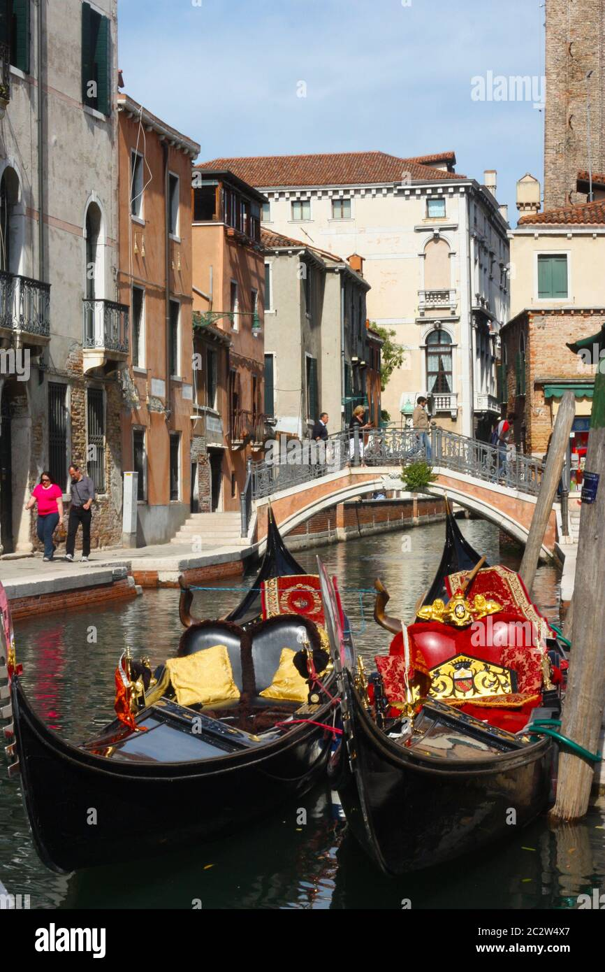Two Gondolas moored in a small canal in the Dorsoduro area in Venice Italy Stock Photo