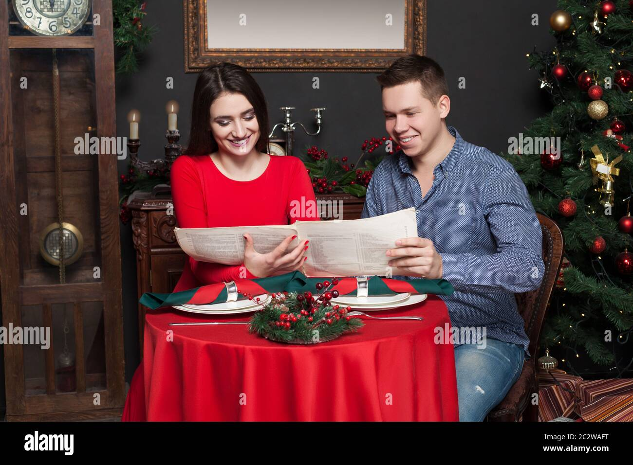 Young Smiling Couple Explore The Menu At Luxury Restaurant Romantic Date Man And Woman In Love Stock Photo Alamy