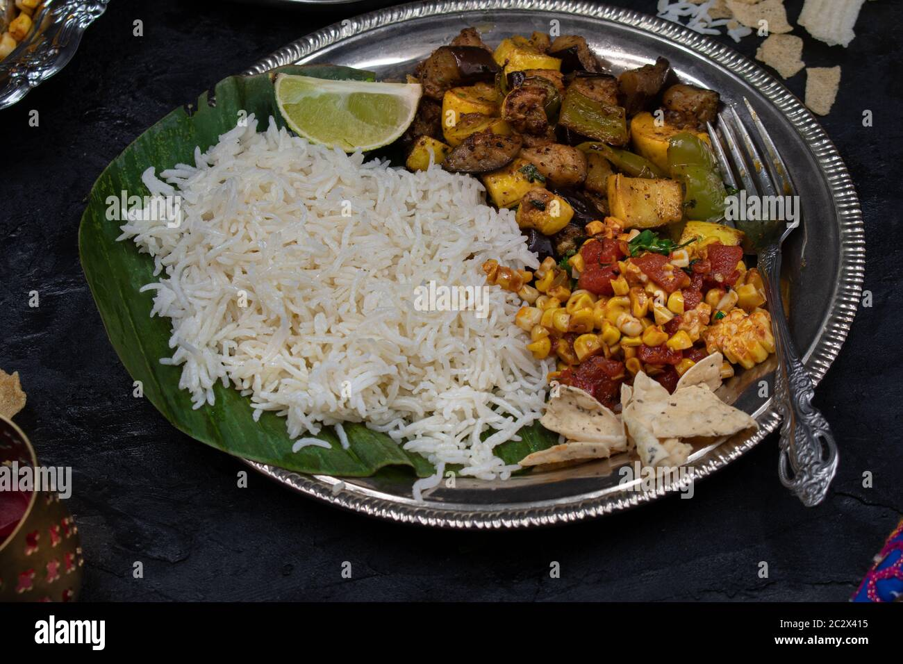 Vegan Indian Meal Served On Silver Plate And Banana Leaf Stock Photo Alamy