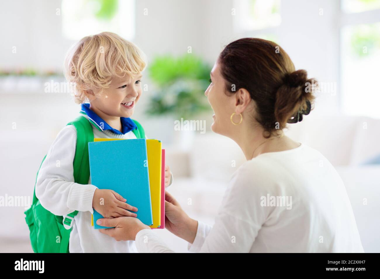 Child going back to school. Mother and kid getting ready for first school  day after vacation. Little boy and mom going to kindergarten or preschool.  S Stock Photo - Alamy
