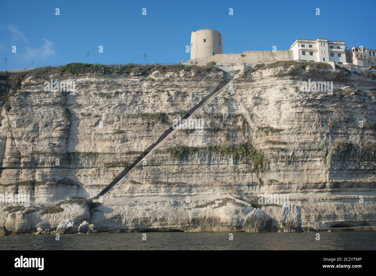 """The Staircase of The King of Aragon (In french: """"Escalier du Roi d'Aragon""""), a famous stony staircase in the commune of Bonifacio, Corsica, France Stock Photo"""
