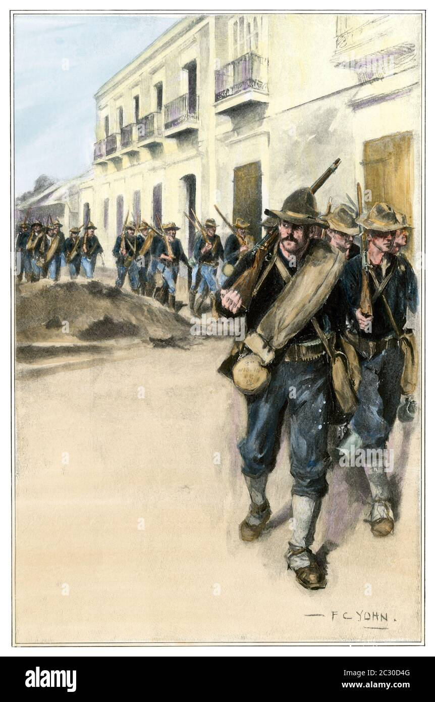 Third Wisconsin Volunteers entering Cuomo, Puerto Rico,  Spanish-American War, 1898. Hand-colored halftone of an F.C. Yohn illustration Stock Photo