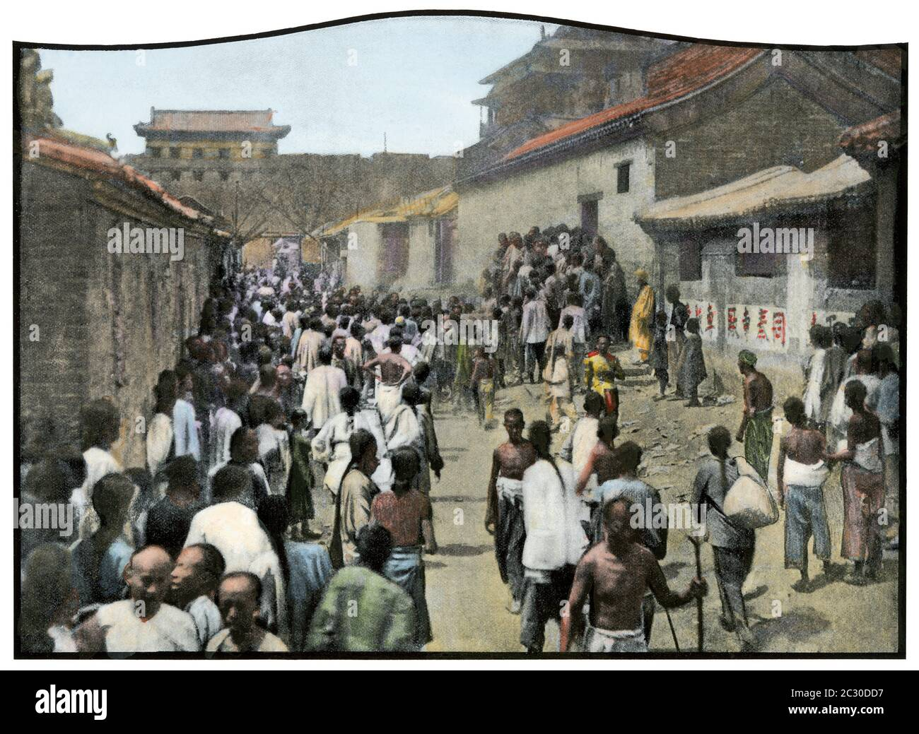 Residents of Peking (Beijing) looting a warehouse during the Boxer Rebellion, 1900. Hand-colored halftone of a photograph Stock Photo