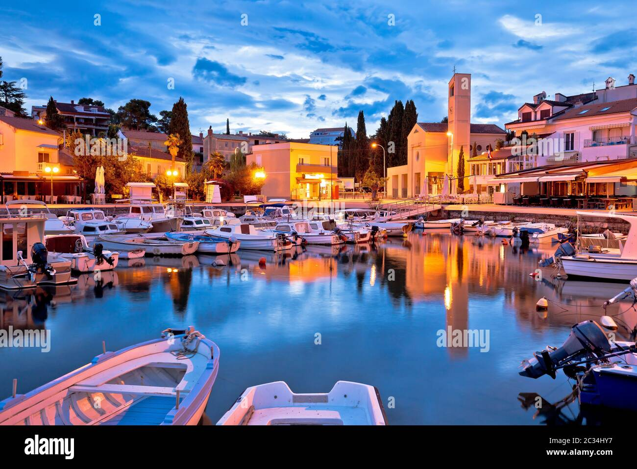 Krk. Town of Malinska waterfront and harbor dawn view, Krk island in Croatia Stock Photo