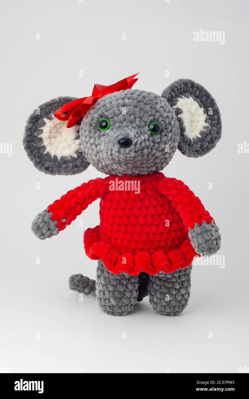 Plush mouse with a red bow on its head Stock Photo