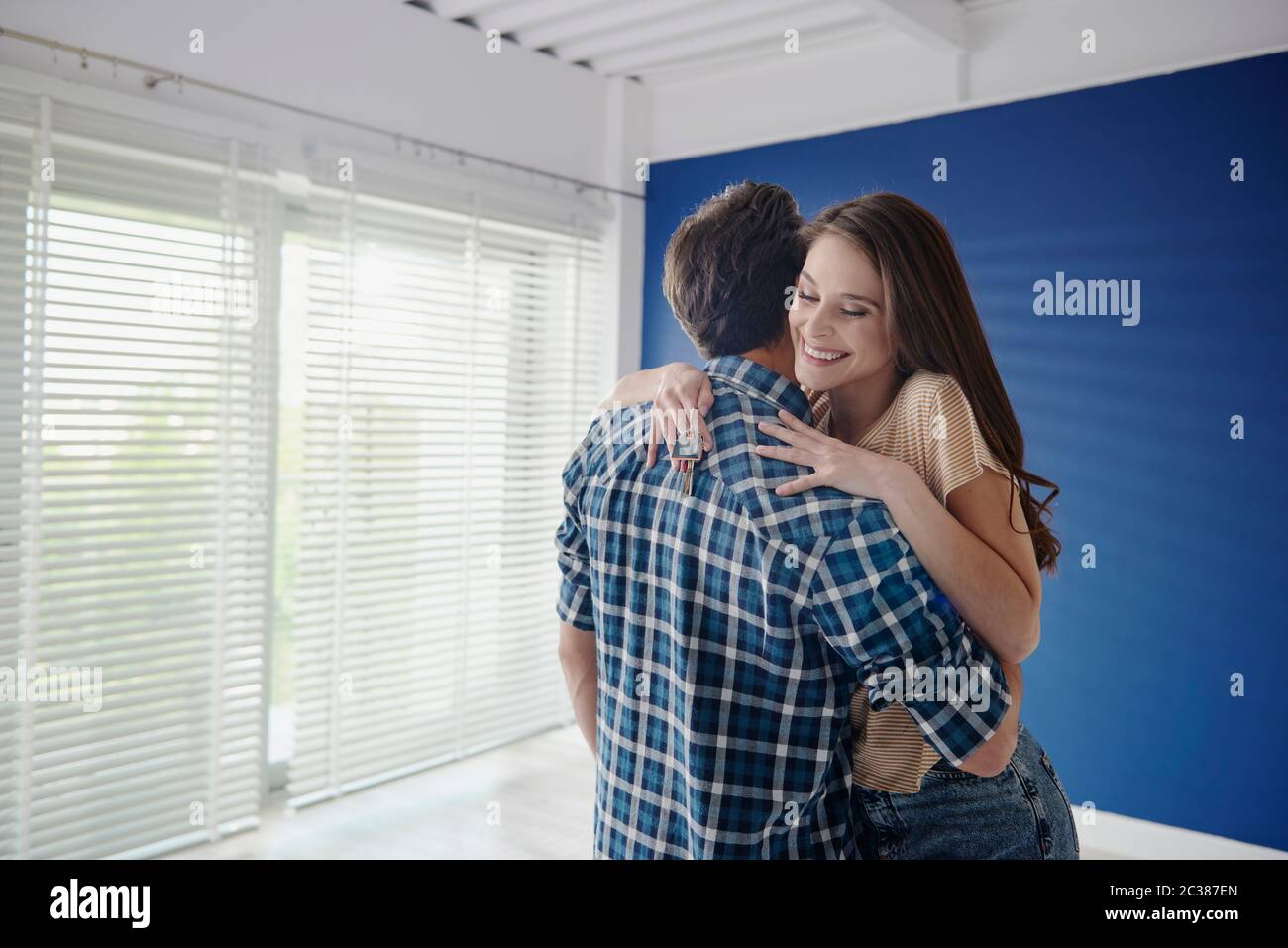 Young couple finally bought a dreamy house Stock Photo