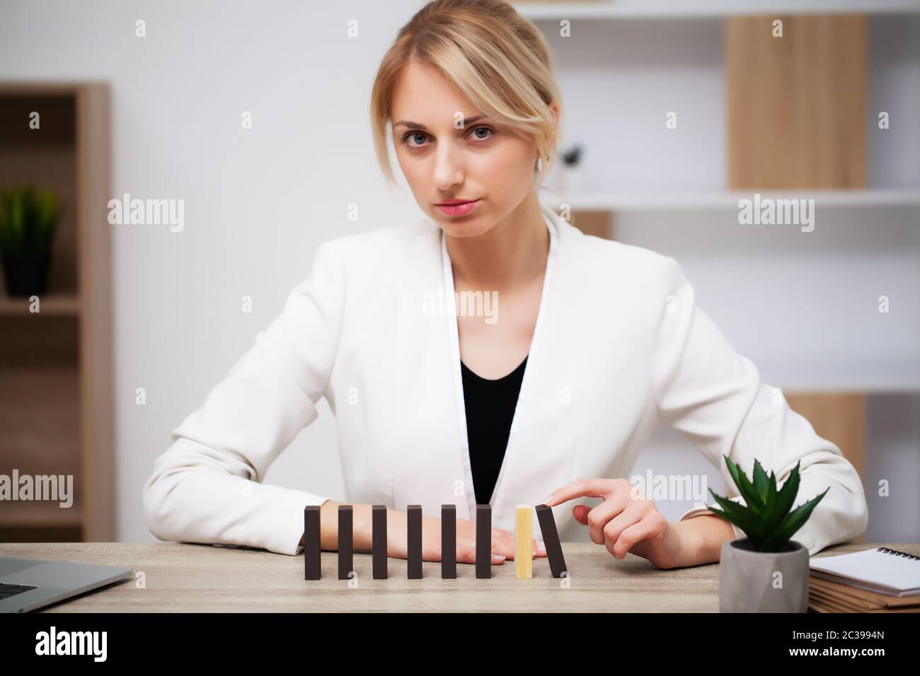 Business growth concept, beautiful young woman businesswoman builds company development plans Stock Photo