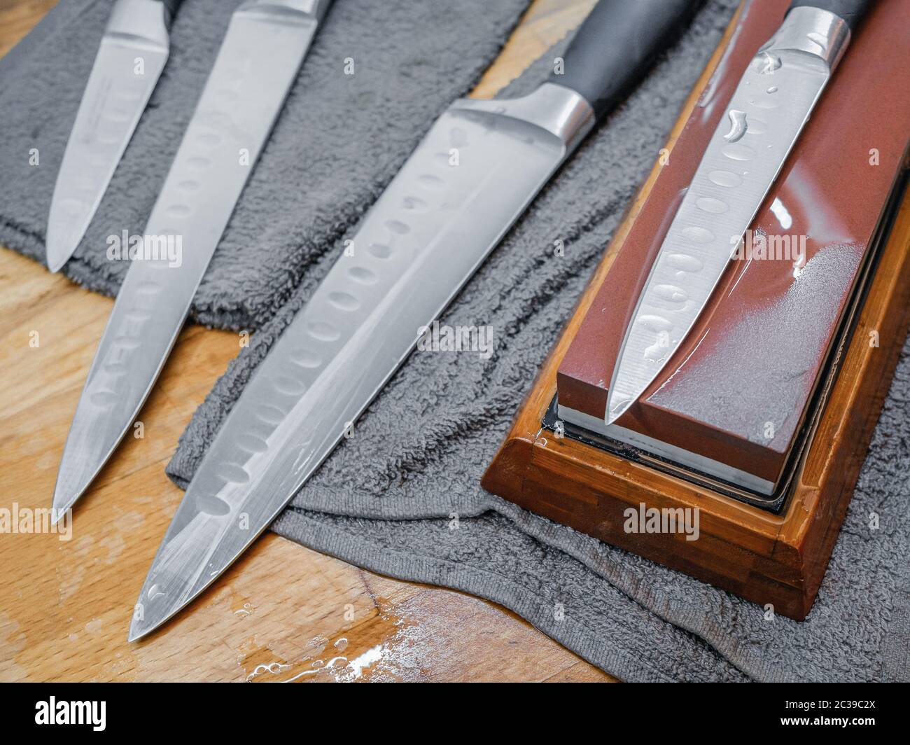 Selective Focus On The Blade Of A Steel Kitchen Knife Lying On A Water Whetstone The Process Of Sharpening A Knife Blade To Razor Sharpness On A Bla Stock Photo Alamy