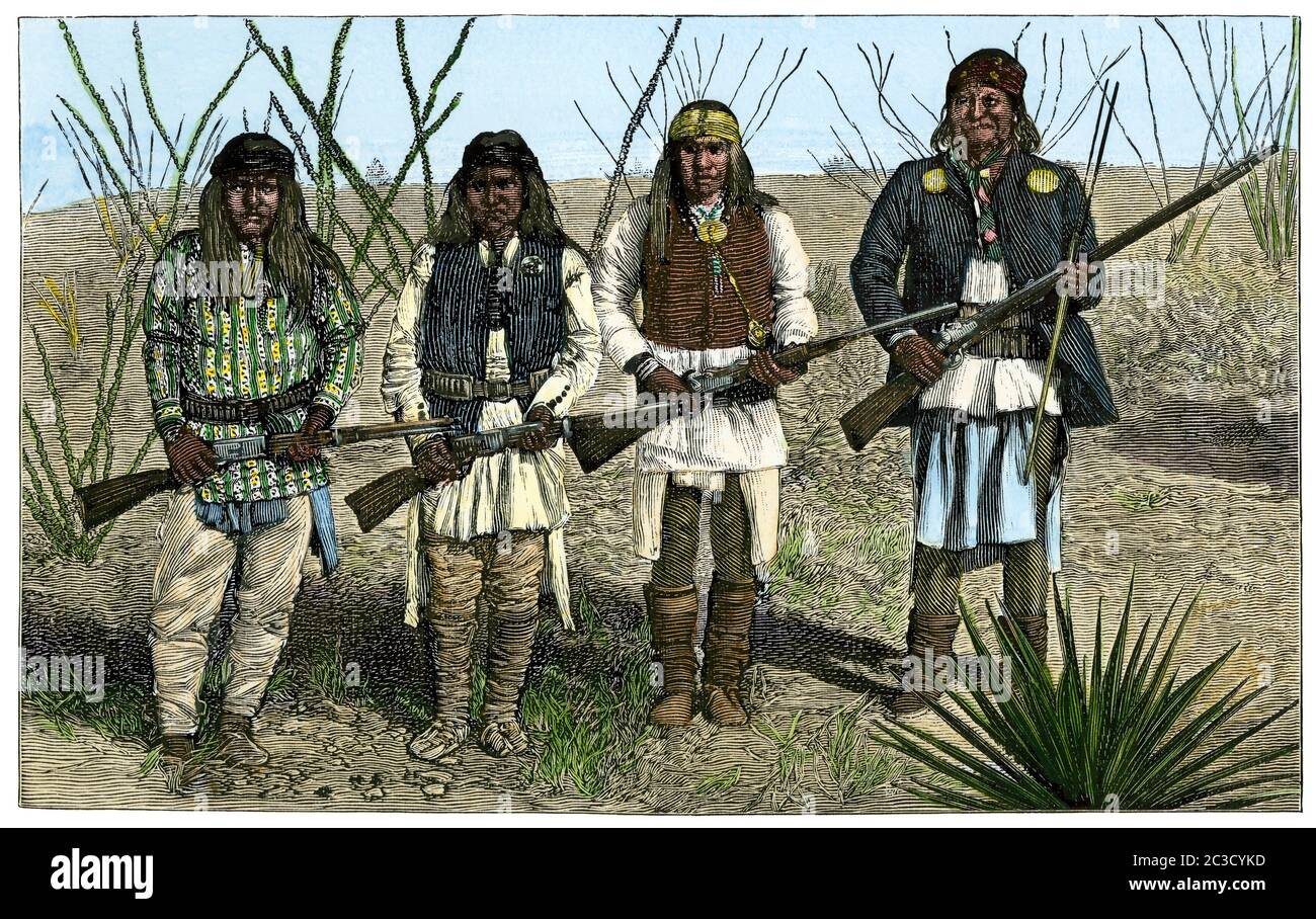 Geronimo (right), his son, and two Apache braves, 1886. Hand-colored woodcut Stock Photo