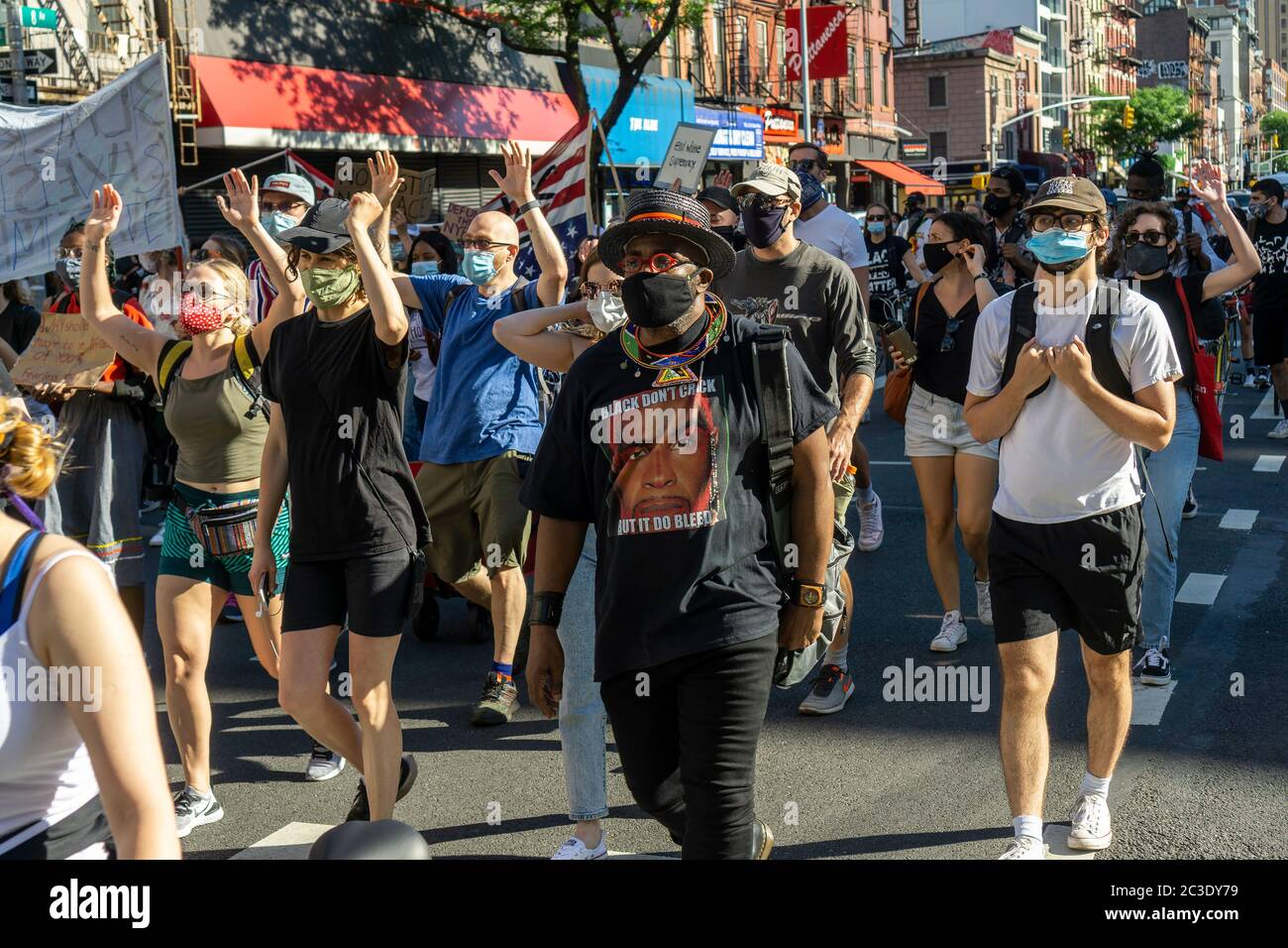 Black Lives Matter demonstrators march in Chelsea in New York protesting the death of George Floyd and calling for defunding the police, seen on Tuesday, June 16, 2020. (© Richard B. Levine) Stock Photo