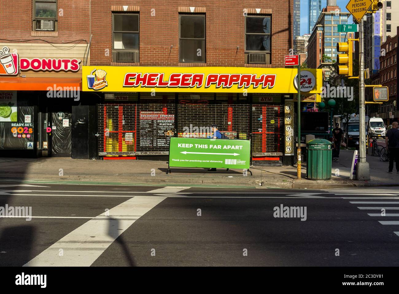 The closed Chelsea Papaya establishment, with a social distancing sign in front of it, in the Chelsea neighborhood of New York on Thursday, June 18, 2020. (© Richard B. Levine) Stock Photo