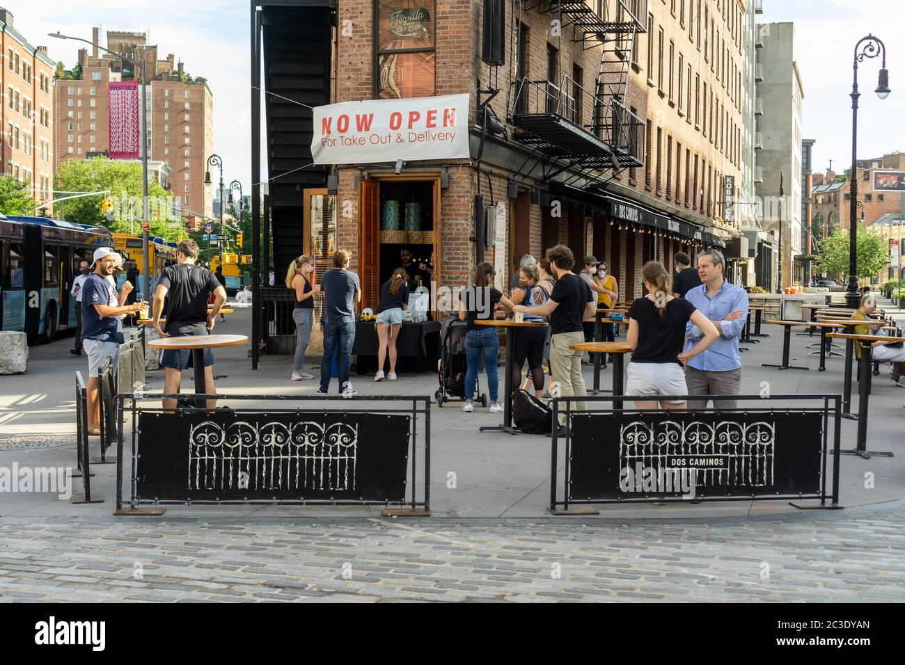 "Customers take advantage of relaxed liquor laws and ""grab and go"" cocktails outside a restaurant in the Meatpacking District in New York on Thursday, June 18, 2020. (© Richard B. Levine) Stock Photo"