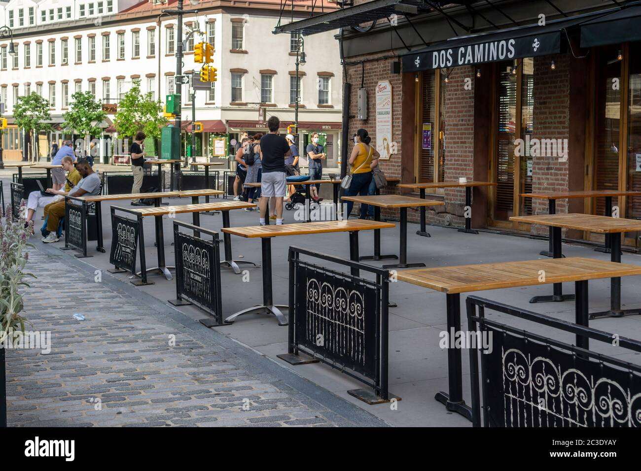 In anticipation of Phase Two of the reopening Dos Caminos in the Meatpacking District in New York sets out tables complying with social distancing protocols, seen on Thursday, June 18, 2020. Phase Two takes effect June 22 in New York City and will allow some outdoor dining.  (© Richard B. Levine) Stock Photo