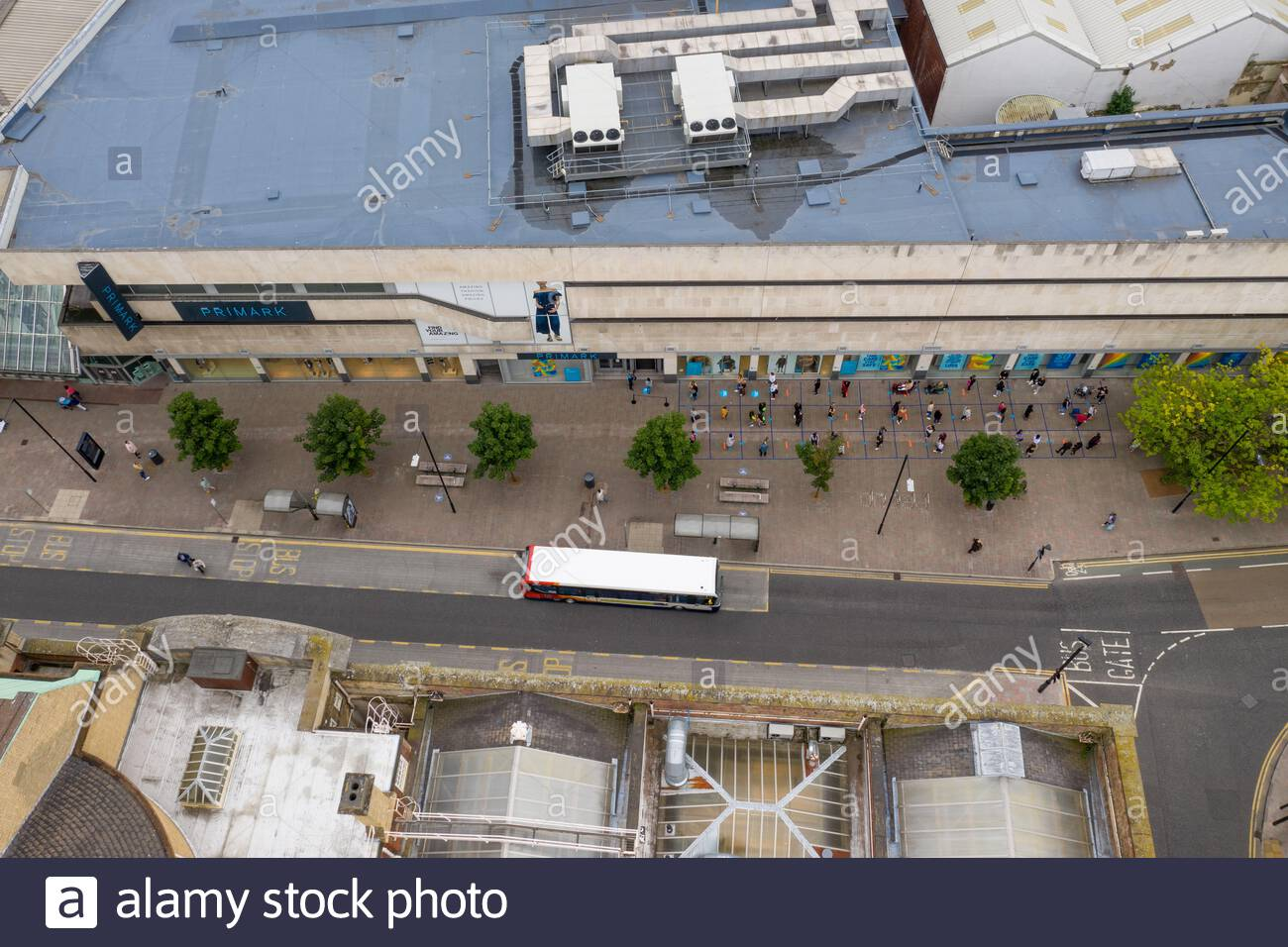 The first day the shops re-opened after the COVID-19 lockdown, social distancing is 2m and people are queue for entry to the shops. 15th June 2020 Stock Photo
