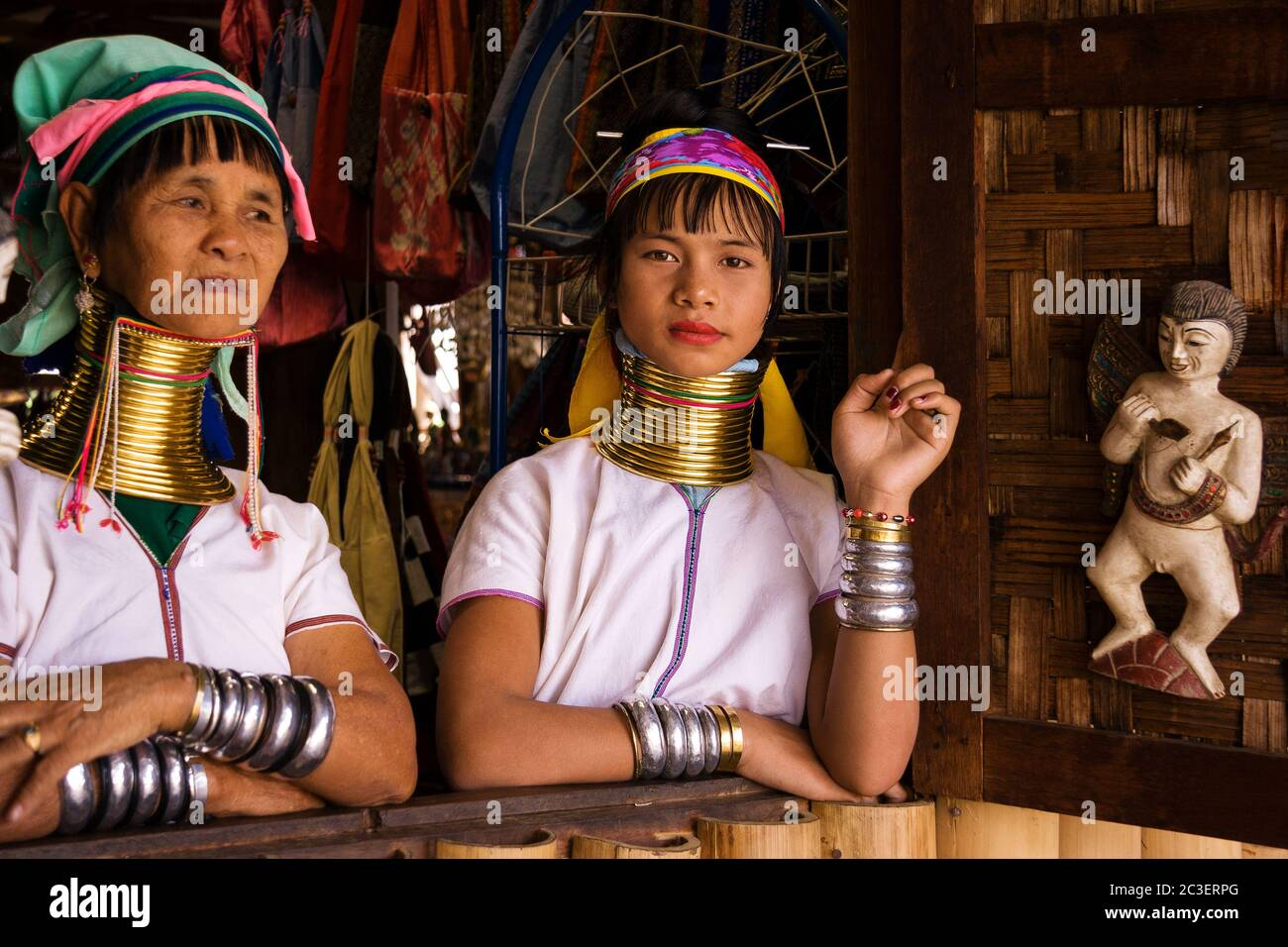 Portrait of two Kayan Lahwi tribe women with neck rings. Stock Photo