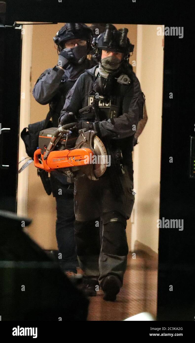 Armed police officers at a block of flats off the Basingstoke Rd in Reading after an incident at Forbury Gardens in Reading town centre. Stock Photo