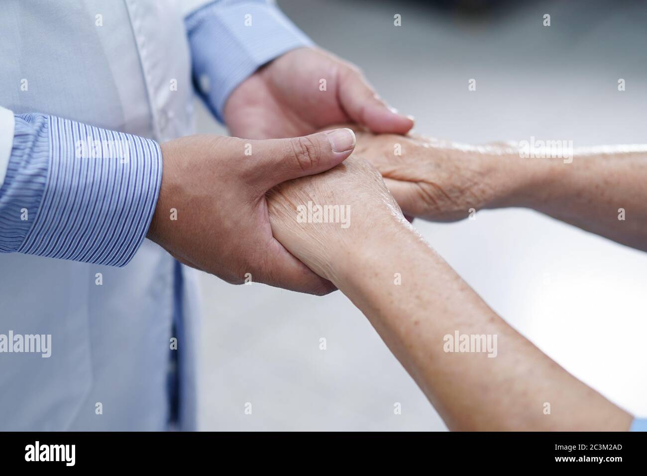 Holding Touching hands Asian senior or elderly old lady woman patient with love, care, helping, encourage and empathy at nursing hospital ward : healt Stock Photo