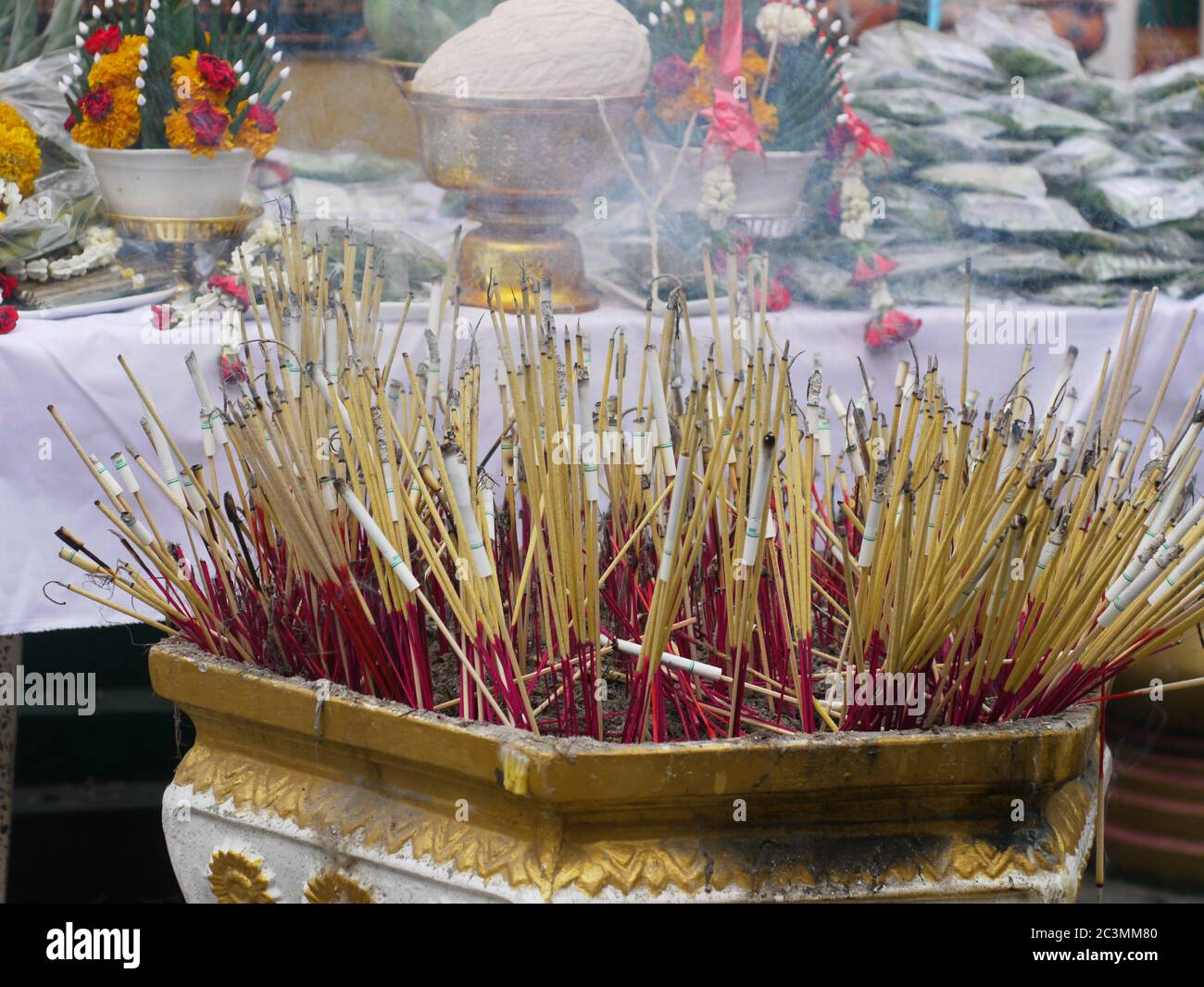 Nakhon Chaisi March 19 Burning Incense Sticks With Cigarettes Attached At The Tattoo Festival At Wat Bang Phra On March 19 2011 In Nakhon Chaisi Stock Photo Alamy