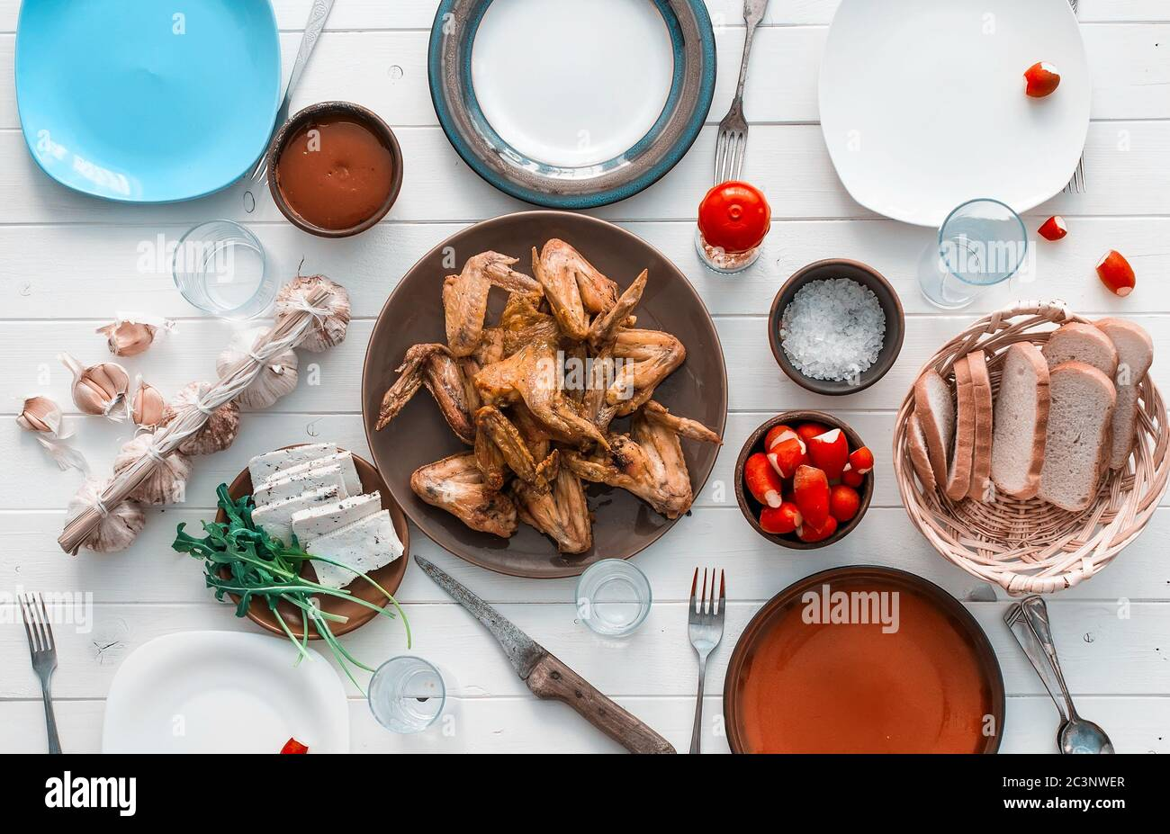 family dinner with roasted chicken wings top view Stock Photo