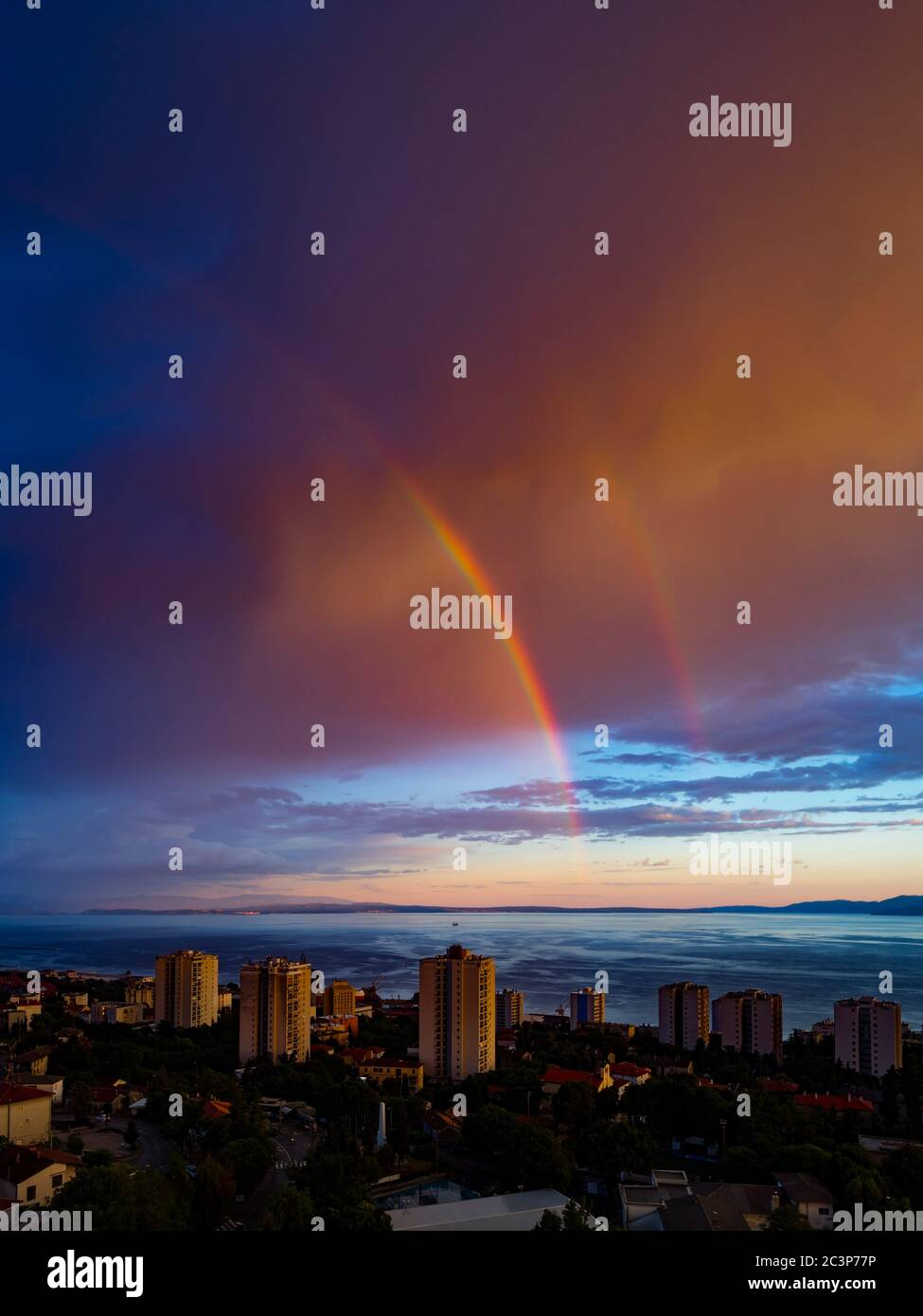 Evening partial from sea double two rainbow Stock Photo