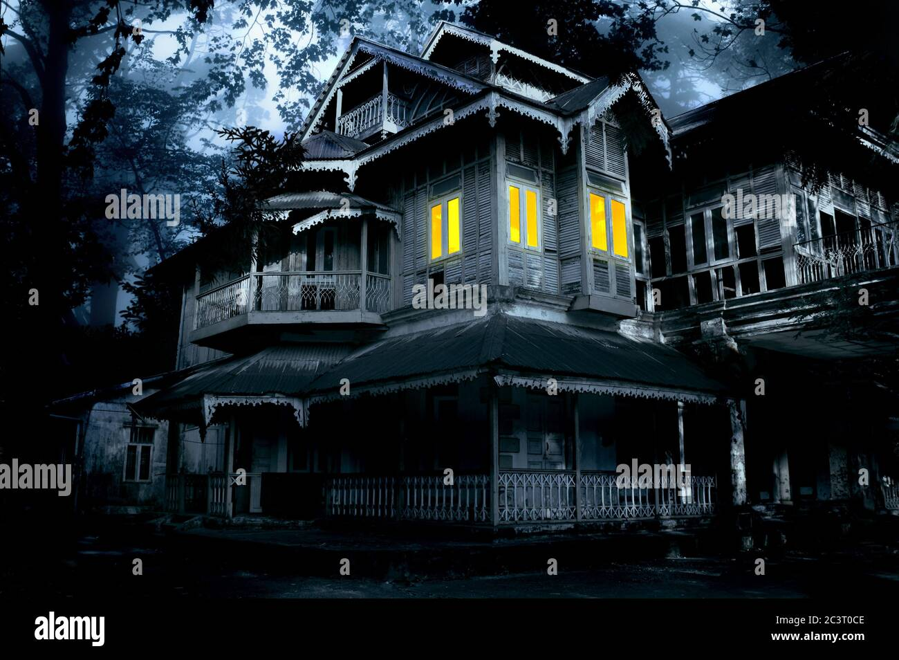 Haunted House Old Abandoned House With Lighted Windows In The Spooky Night Forest Scary Colonial Cottage In Mysterious Forestland Photo Toned In Bl Stock Photo Alamy