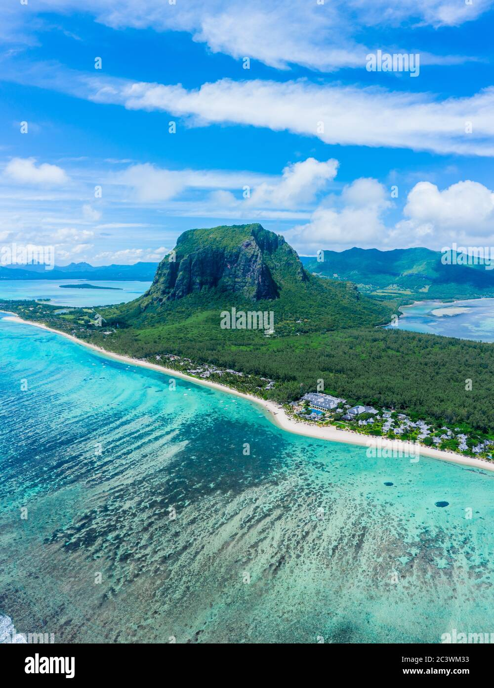 Aerial panoramic view of Mauritius island - Detail of Le Morne Brabant mountain with underwater waterfall perspective optic illusion - Wanderlust and Stock Photo