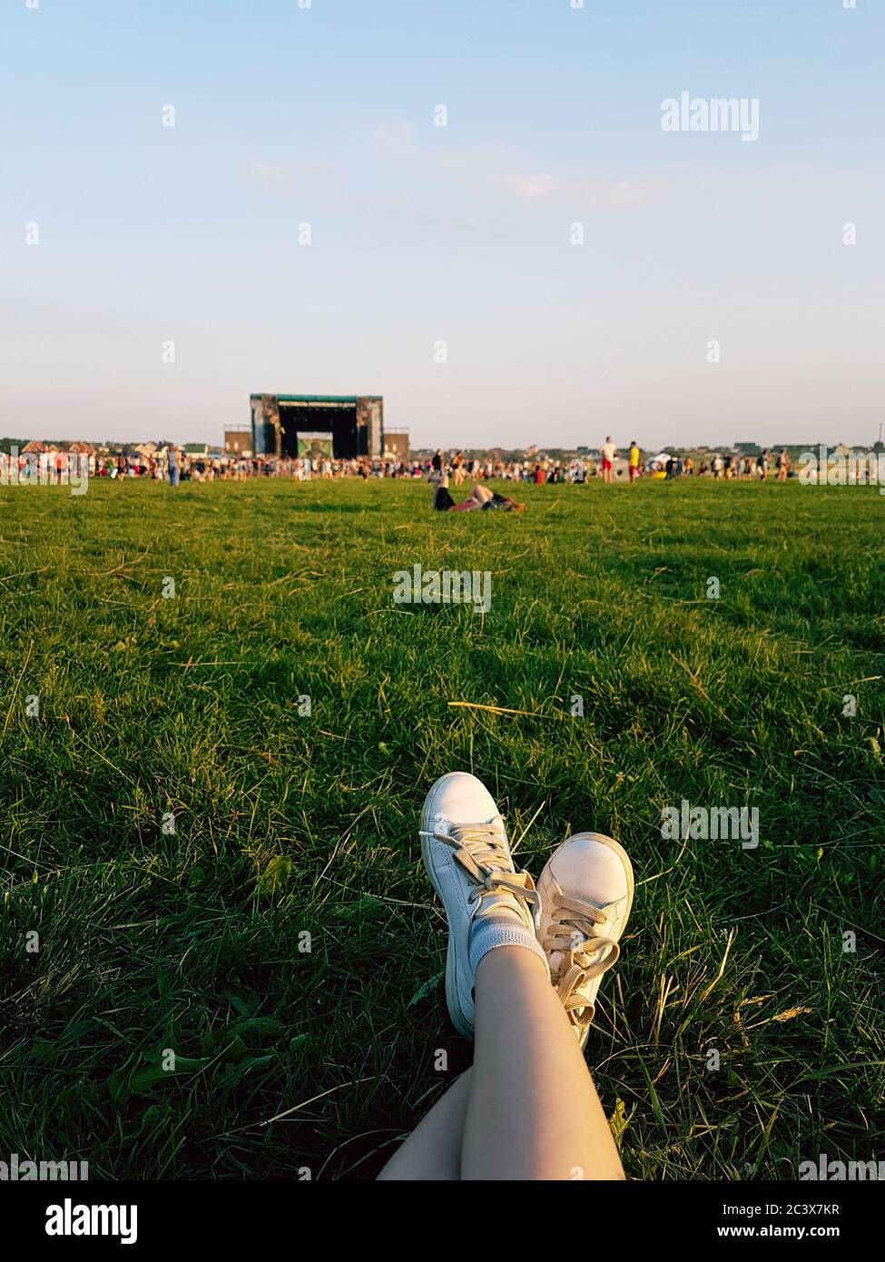 Relaxing at open air music festival in Ukraine. Traditional celebration with famous music groups performing on stage. Listening to live music Stock Photo
