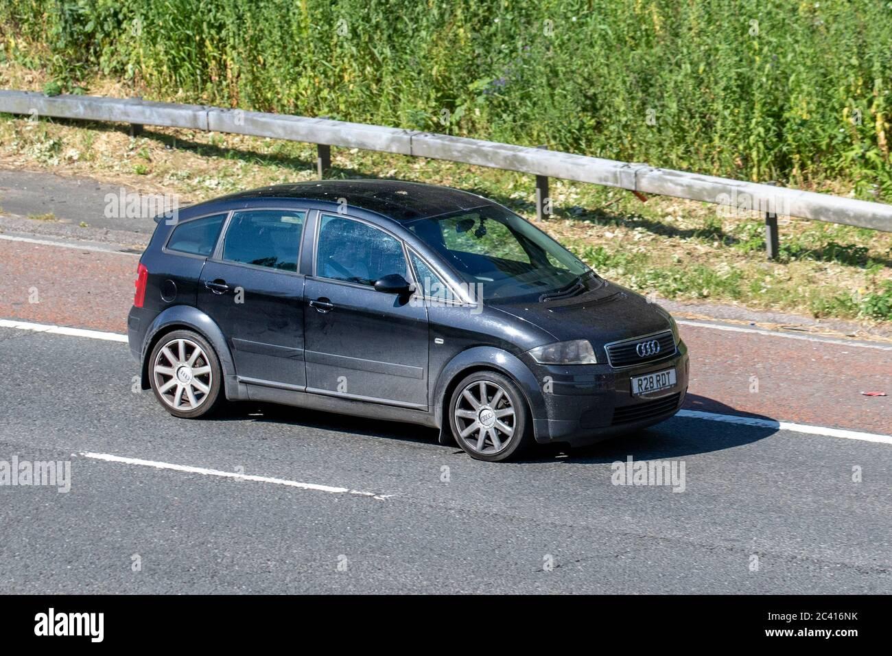 2004 black Audi A2 TDI 90Bhp; Vehicular traffic moving vehicles, cars driving vehicle on UK roads, motors, motoring on the M6 motorway Stock Photo