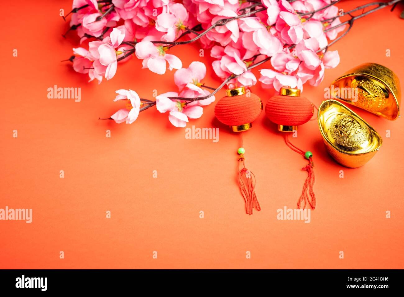 """Chinese New Year background. The wordings on gold bar is chinese words which means """"to bring in wealth and treasure"""" Stock Photo"""
