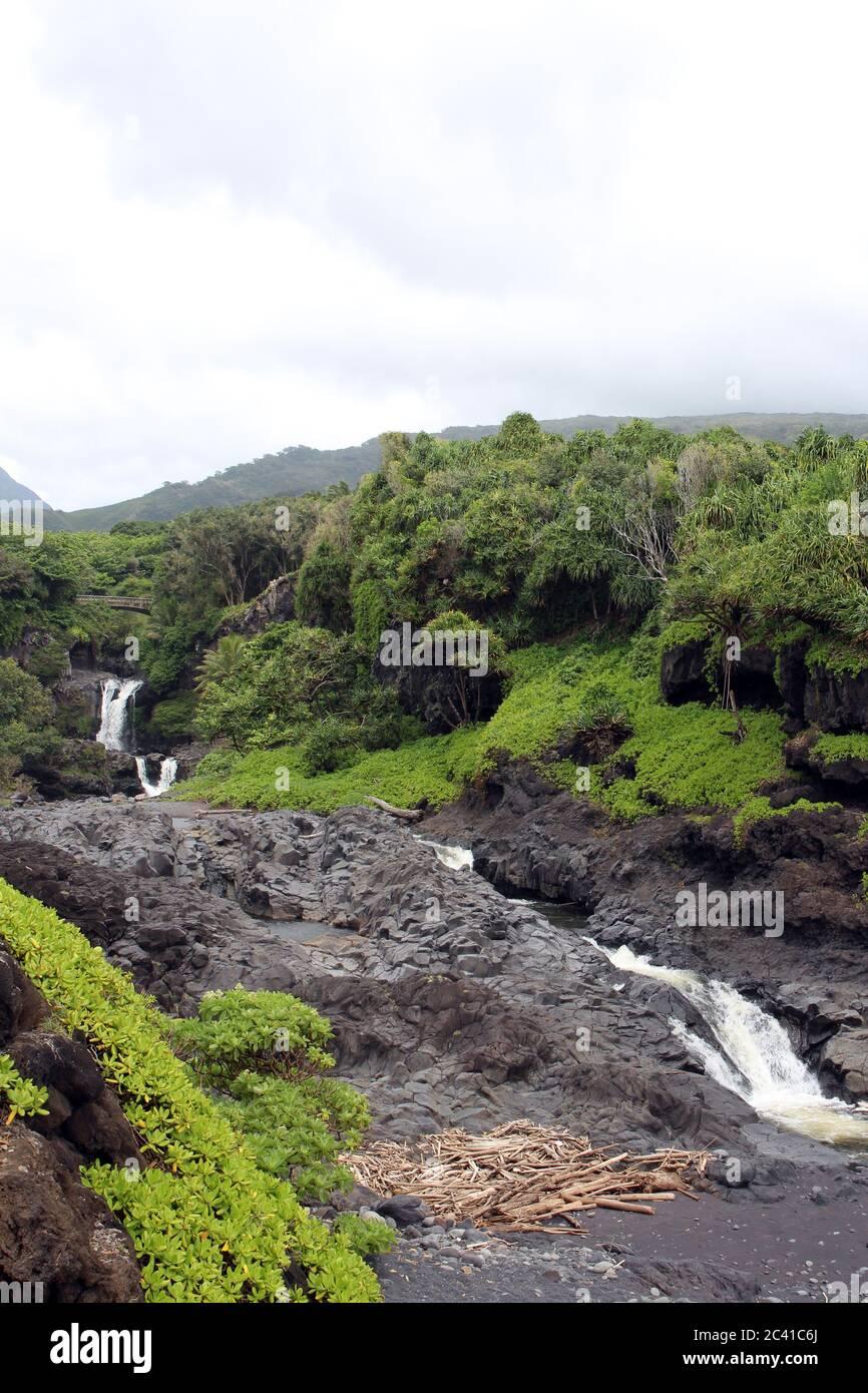 Multiple waterfalls of the Seven Sacred Pools, O'heo Gulch, in Haleakala National Park, Maui, Hawaii, USA Stock Photo