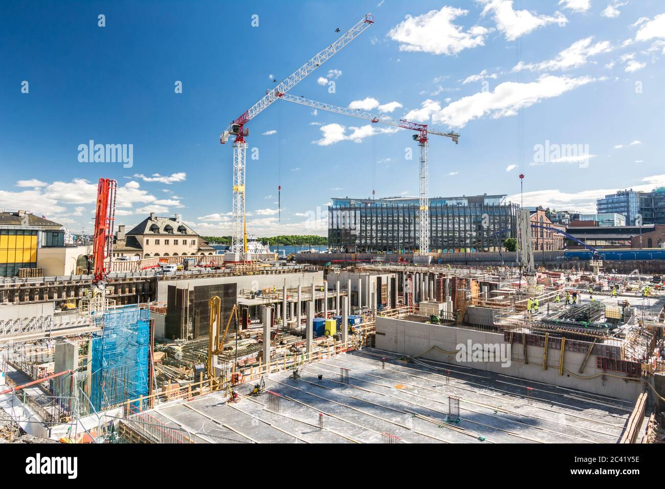 Horizontal shot of large construction site with foundations and cranes Stock Photo