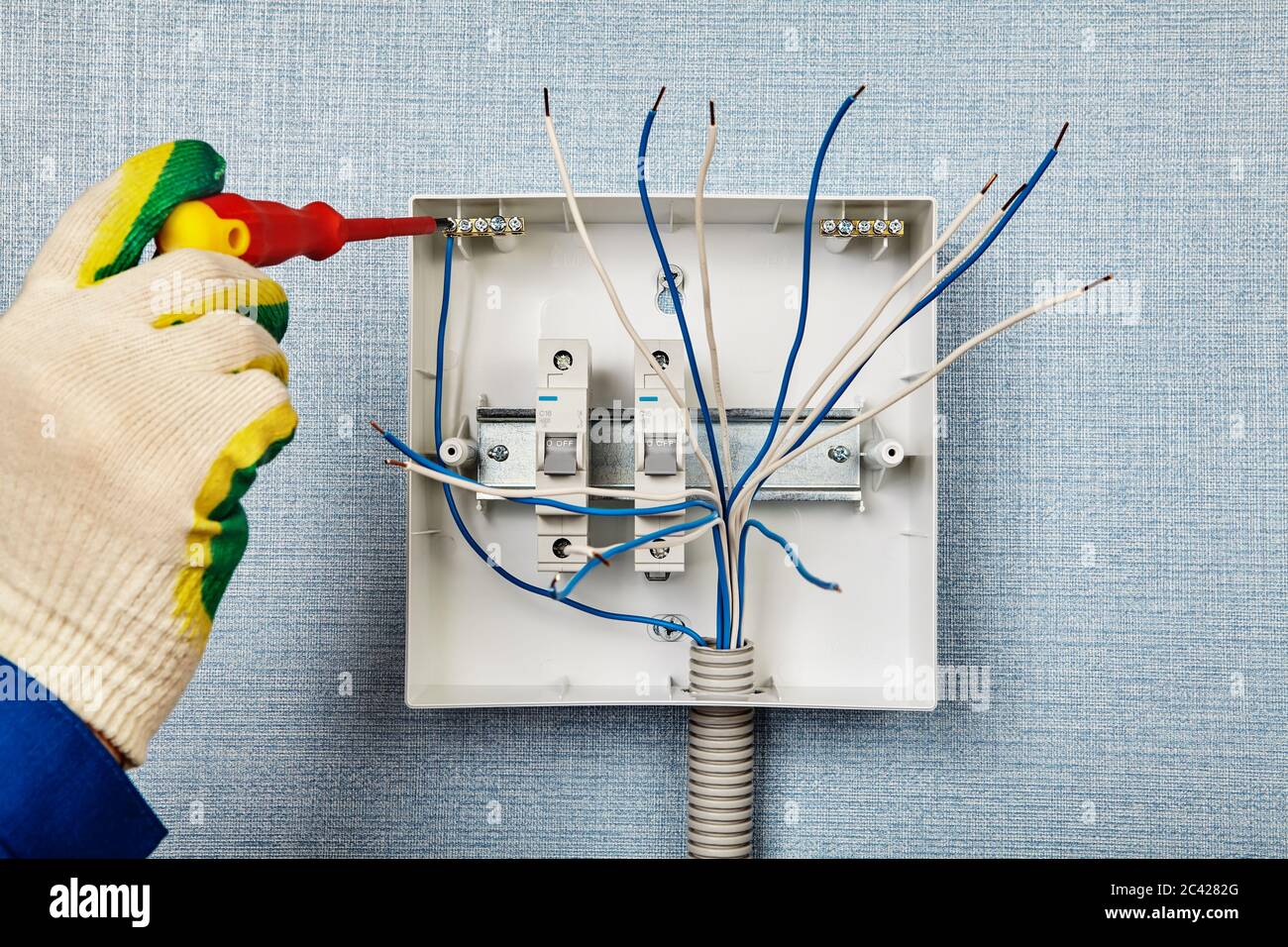 Installation Of A Switchboard Or Consumer Unit An Electrician Secures A Copper Wire To A Neutral Bar The Installer Installs A Fuse Box Or Circuit B Stock Photo Alamy