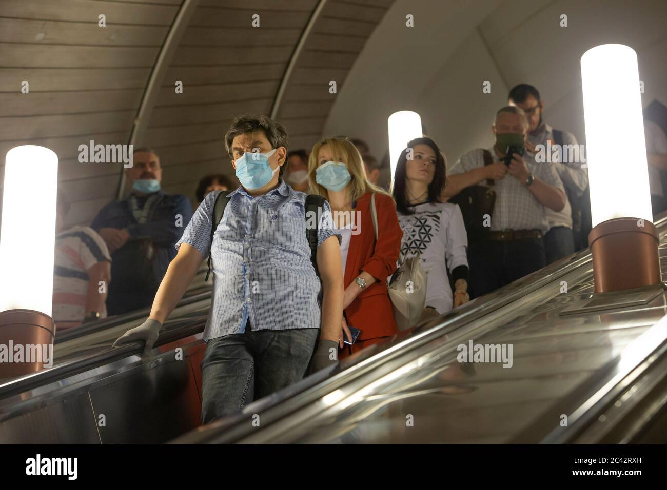 Moscow, Russia. 23rd June, 2020. People wearing face masks ride the escalator at a subway station in Moscow, Russia, on June 23, 2020. Russia recorded 7,425 COVID-19 cases in the past 24 hours, taking its total to 599,705, the country's coronavirus response center said in a statement Tuesday. Credit: Alexander Zemlianichenko Jr/Xinhua/Alamy Live News Stock Photo