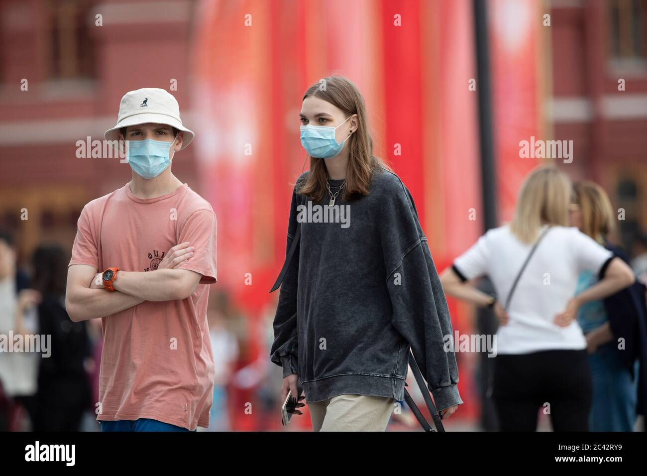 Moscow, Russia. 23rd June, 2020. People wearing face masks walk on a street in Moscow, Russia, on June 23, 2020. Russia recorded 7,425 COVID-19 cases in the past 24 hours, taking its total to 599,705, the country's coronavirus response center said in a statement Tuesday. Credit: Alexander Zemlianichenko Jr/Xinhua/Alamy Live News Stock Photo