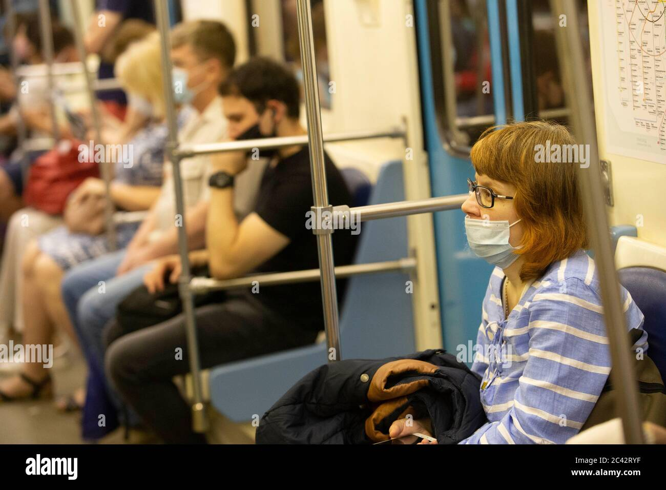 Moscow, Russia. 23rd June, 2020. Passengers wearing face masks sit in the subway train in Moscow, Russia, on June 23, 2020. Russia recorded 7,425 COVID-19 cases in the past 24 hours, taking its total to 599,705, the country's coronavirus response center said in a statement Tuesday. Credit: Alexander Zemlianichenko Jr/Xinhua/Alamy Live News Stock Photo