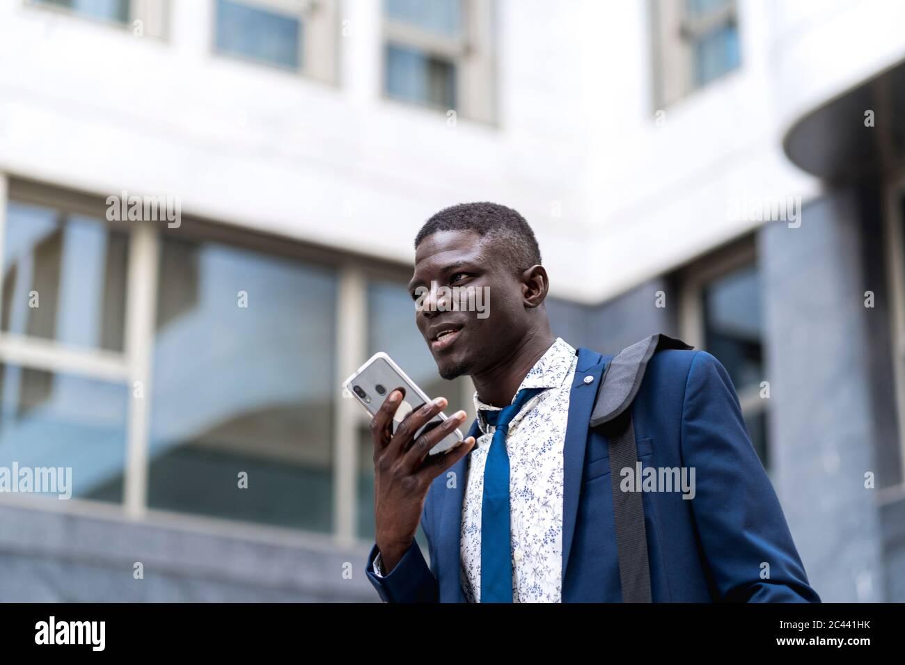 Portrait of businessman using mobile phone Stock Photo