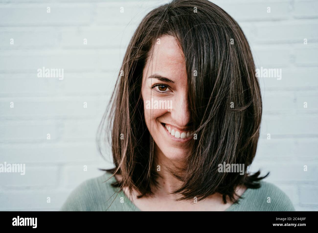 Portrait of happy woman with brown hair Stock Photo