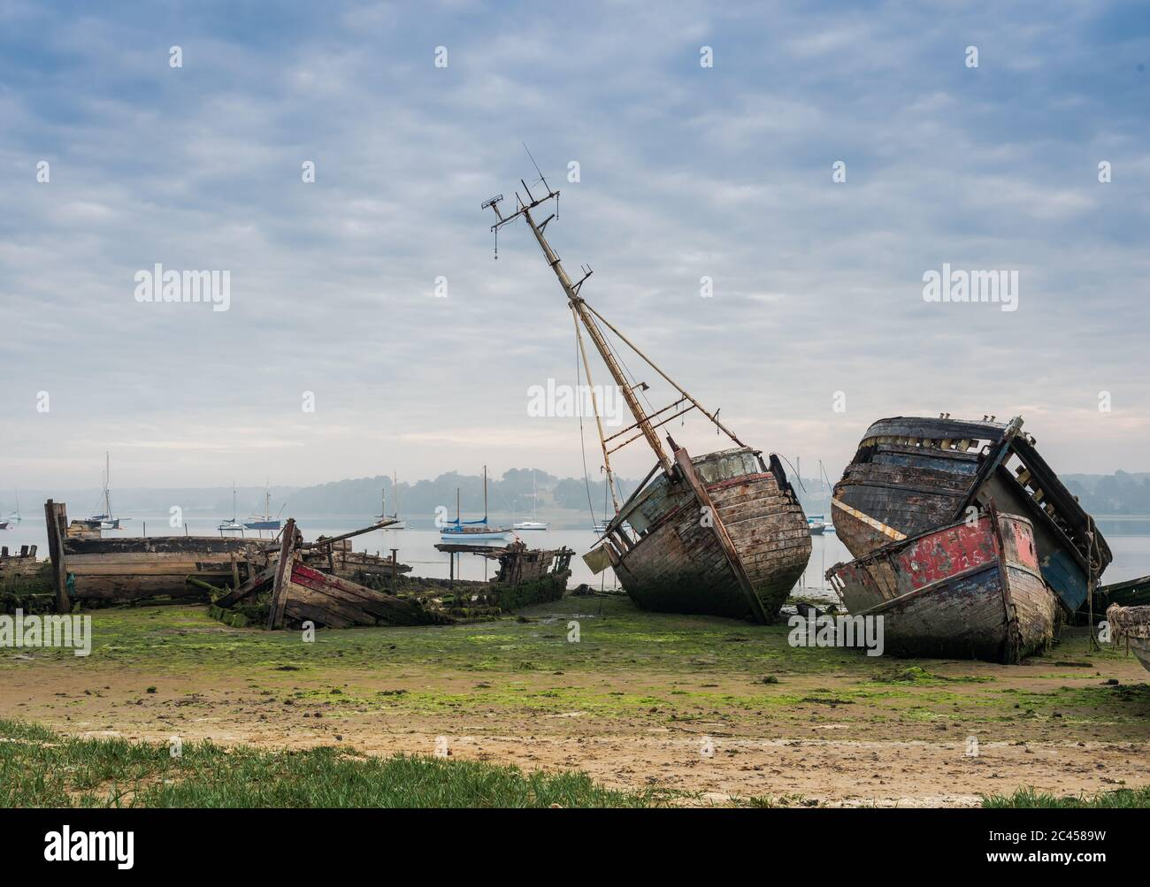 Views of boat wrecks at Pin Mill on the River Orwell just outside Ipswich, Suffolk, UK. Famous for its boat wrecks and great for photographers. Stock Photo