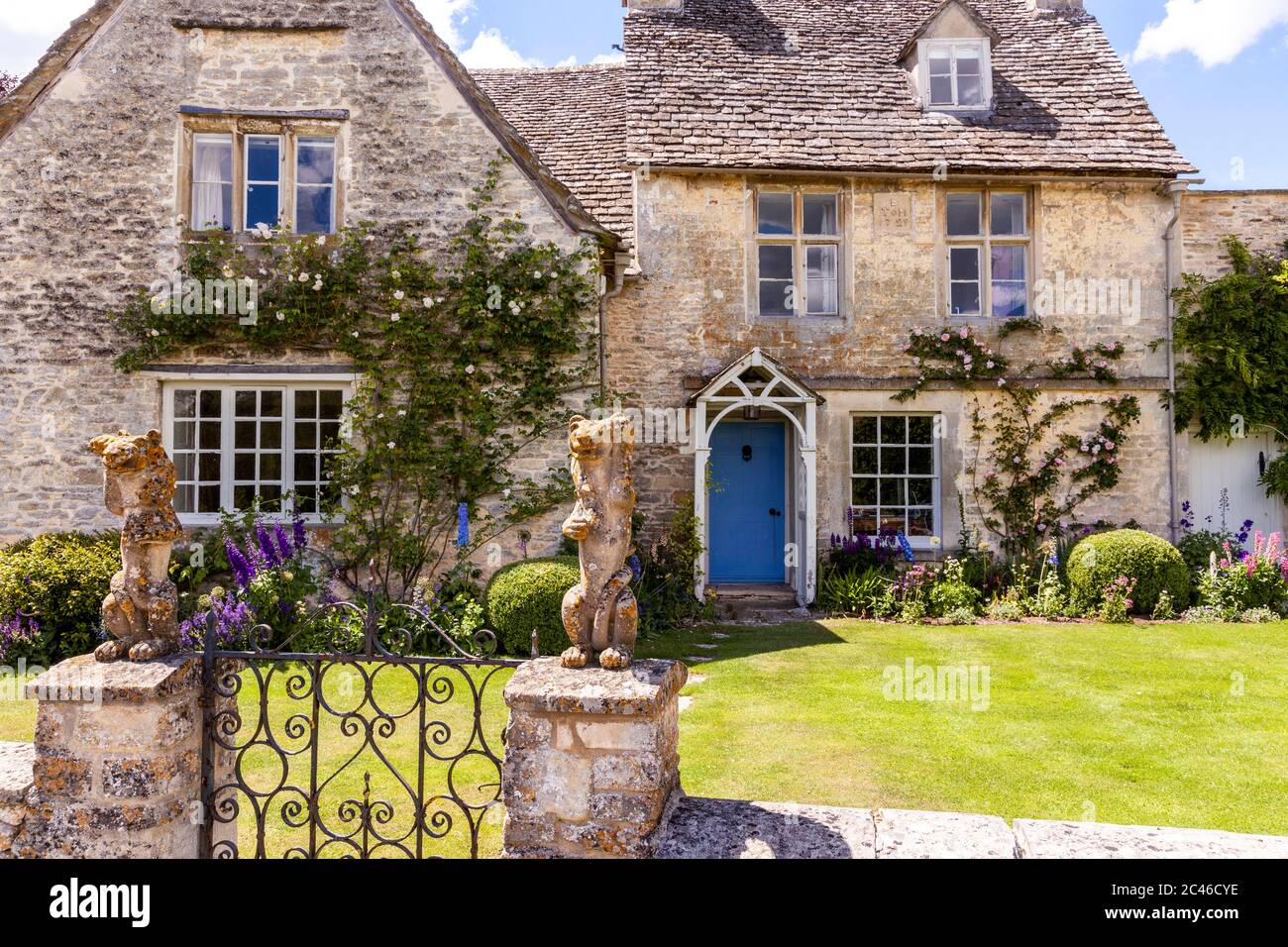 A typical old stone house in the Coln Valley in the Cotswold village of Winson, Gloucestershire UK Stock Photo