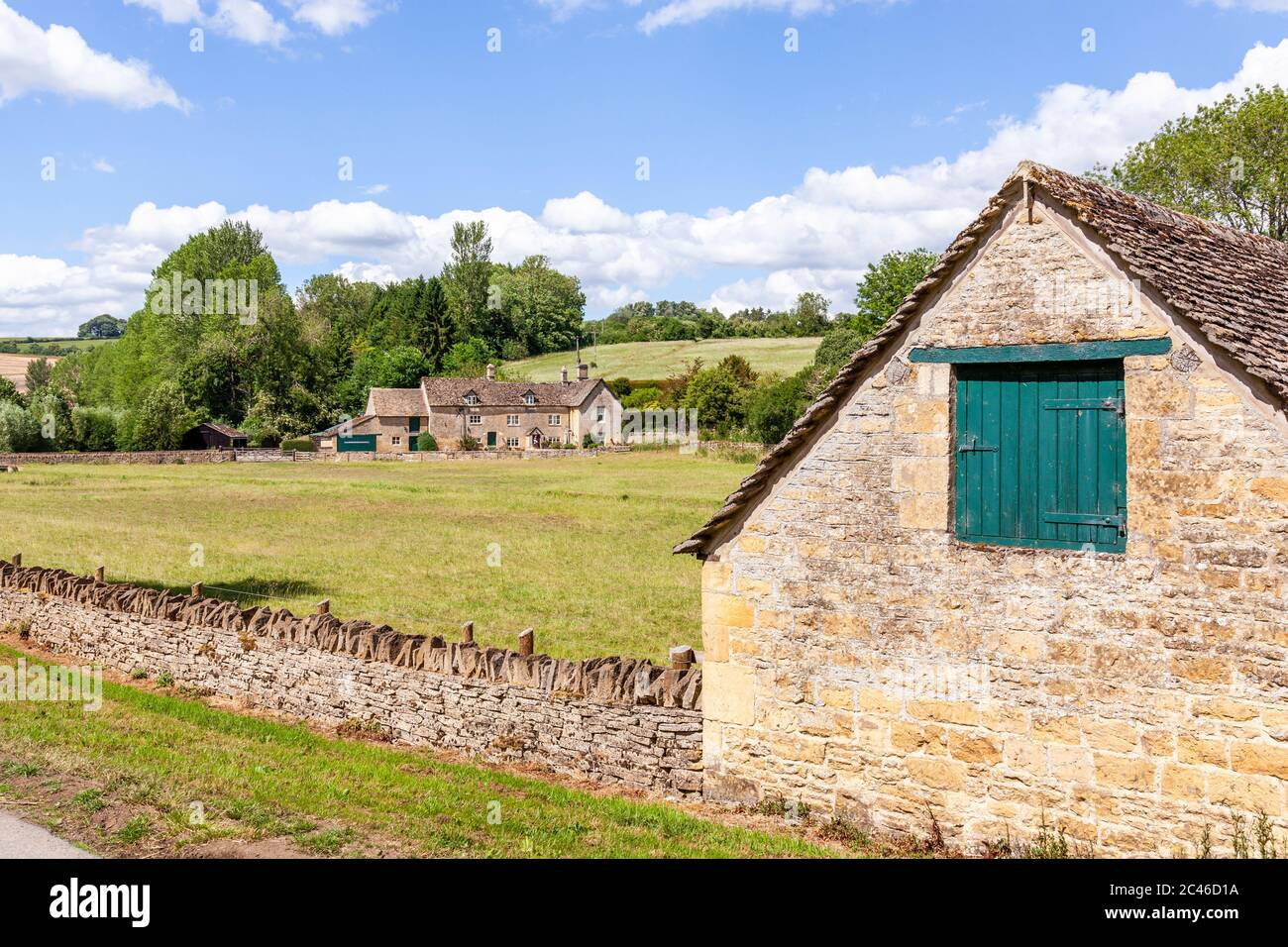 The Coln Valley - looking across to Yanworth Mill beside the River Coln near the Cotswold village of Yanworth, Gloucestershire UK Stock Photo