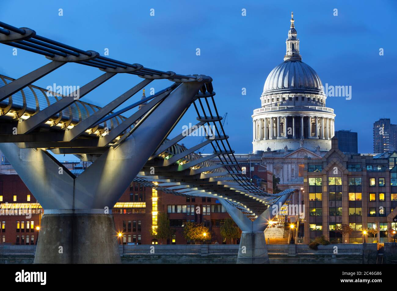 Millennium Bridge over River Thames and St Paul's Cathedral at dusk, London, England, United Kingdom, Europe Stock Photo