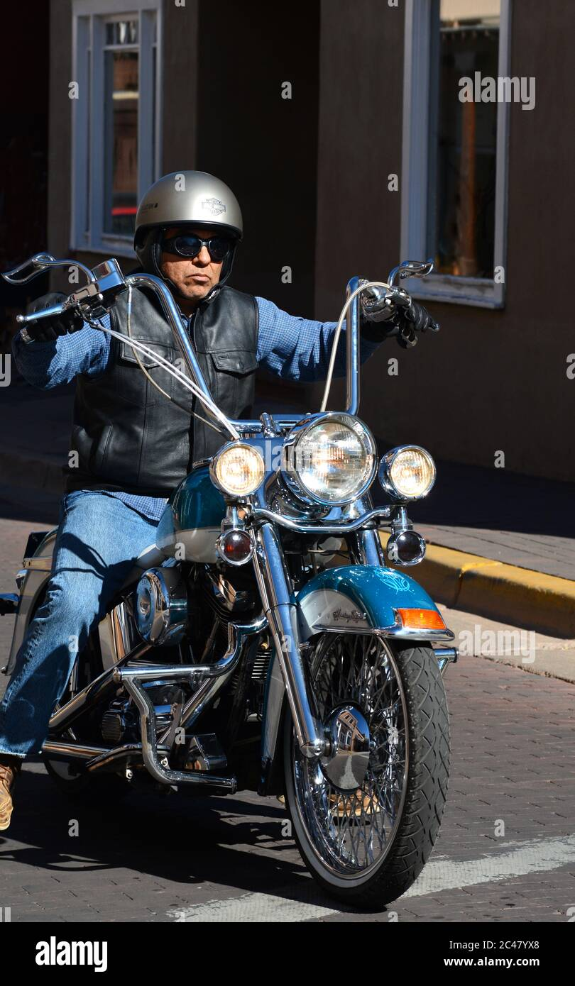 A Man Riding A Customized Harley Davidson Motorcycle With Ape Hanger Handlebars Rides Along A Street In Santa Fe New Mexico Stock Photo Alamy