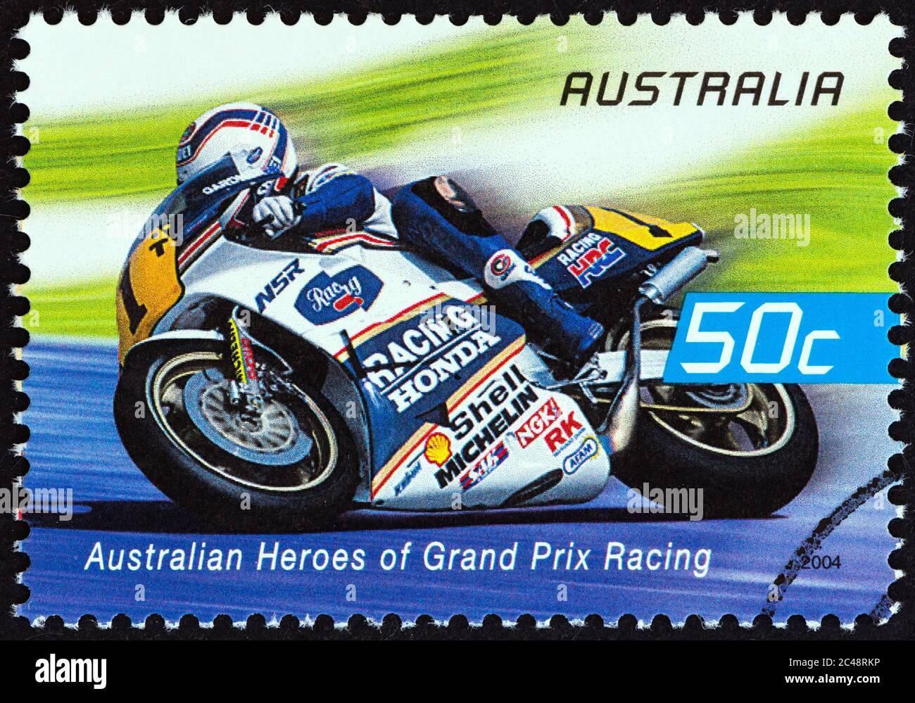 "AUSTRALIA - CIRCA 2004: A stamp printed in Australia from the ""Australian Heroes of Grand Prix Racing"" issue shows Wayne Gardner (Rothmans Honda) Stock Photo"