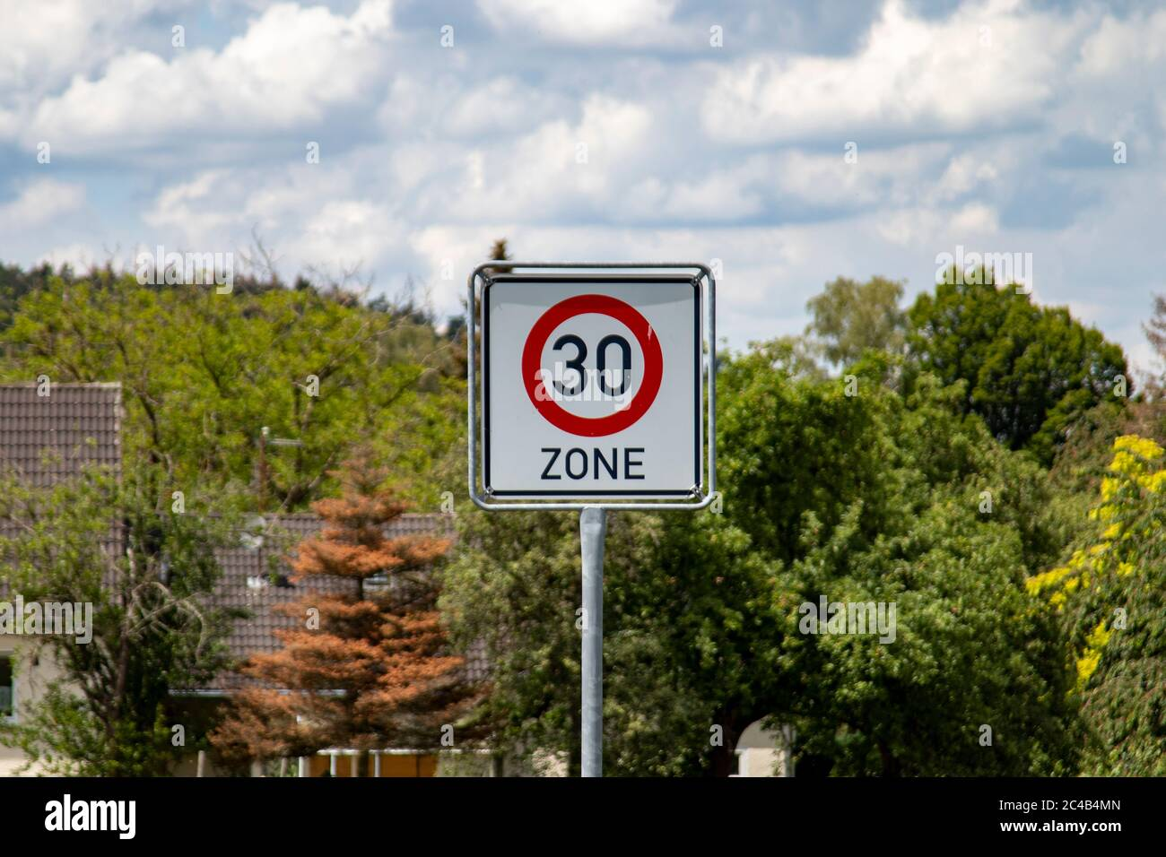 German road sign zone 30 km / h in a rural area, outdoors Stock Photo