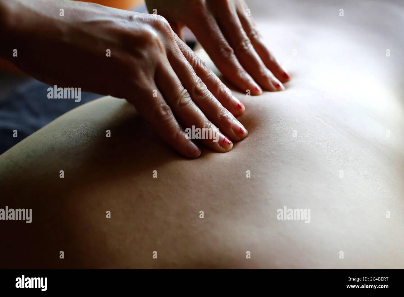 Woman receiving massage on spa massage table Stock Photo