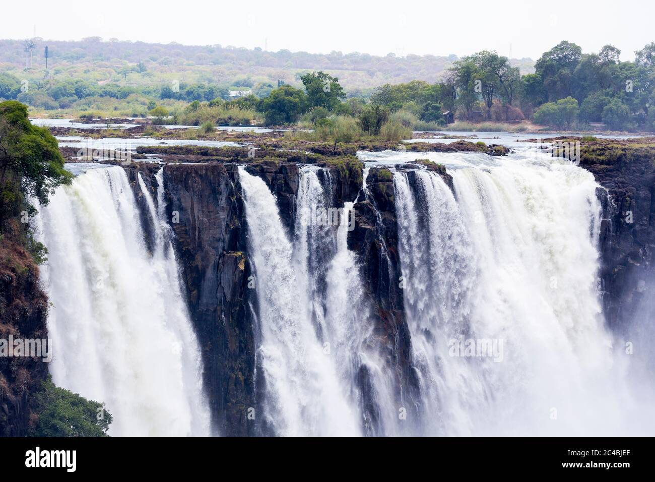 Victoria Falls, waterfall on the Zambezi River, cascades of water tumbling over a steep cliff. Stock Photo