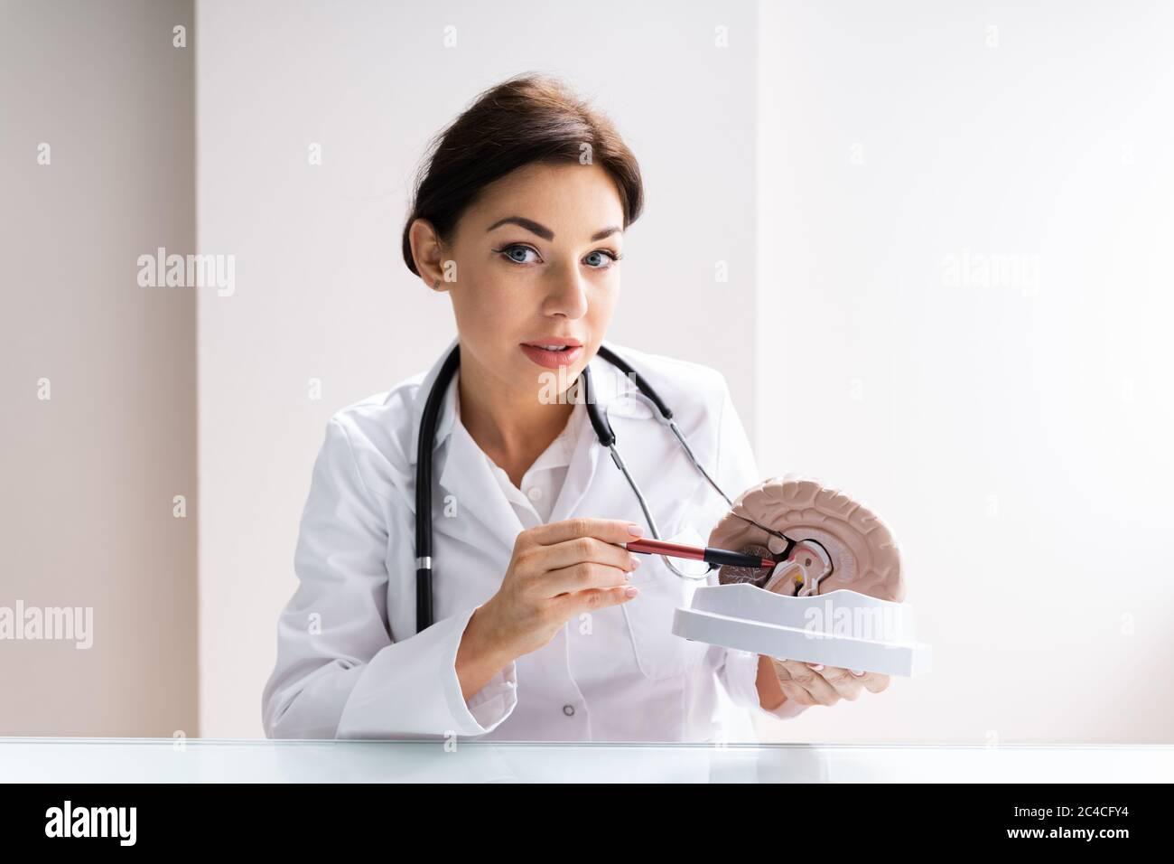 Brain Surgeon Or Neurologist Doctor Explaining To Patient Stock Photo