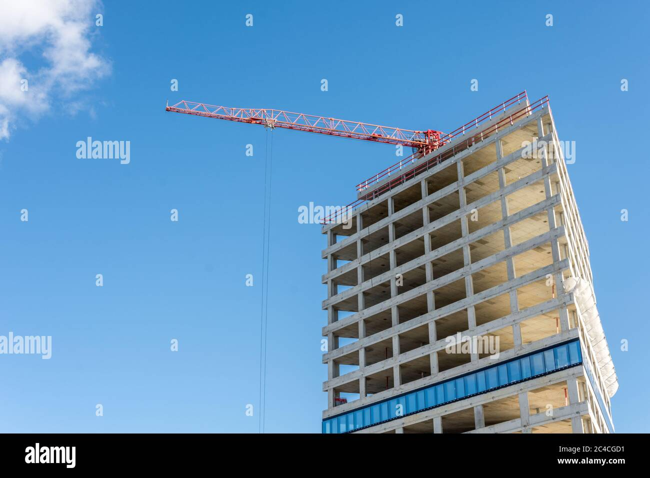 Construction Site With Crane On Blue Sky - Modern Office And Residential Building Under Construction Stock Photo