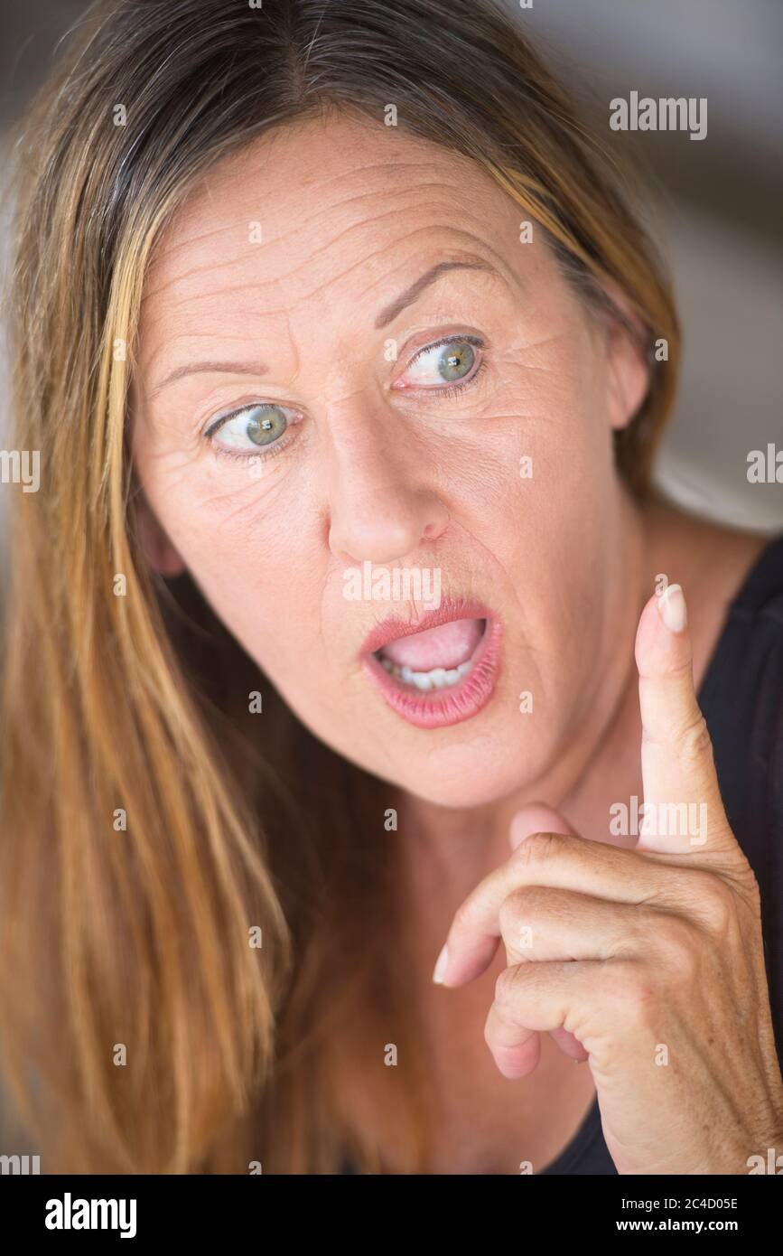 Mature facial pics Portrait Attractive Mature Woman Surprised Shocked Interested Facial Expression With Point Finger Blurred Background Stock Photo Alamy