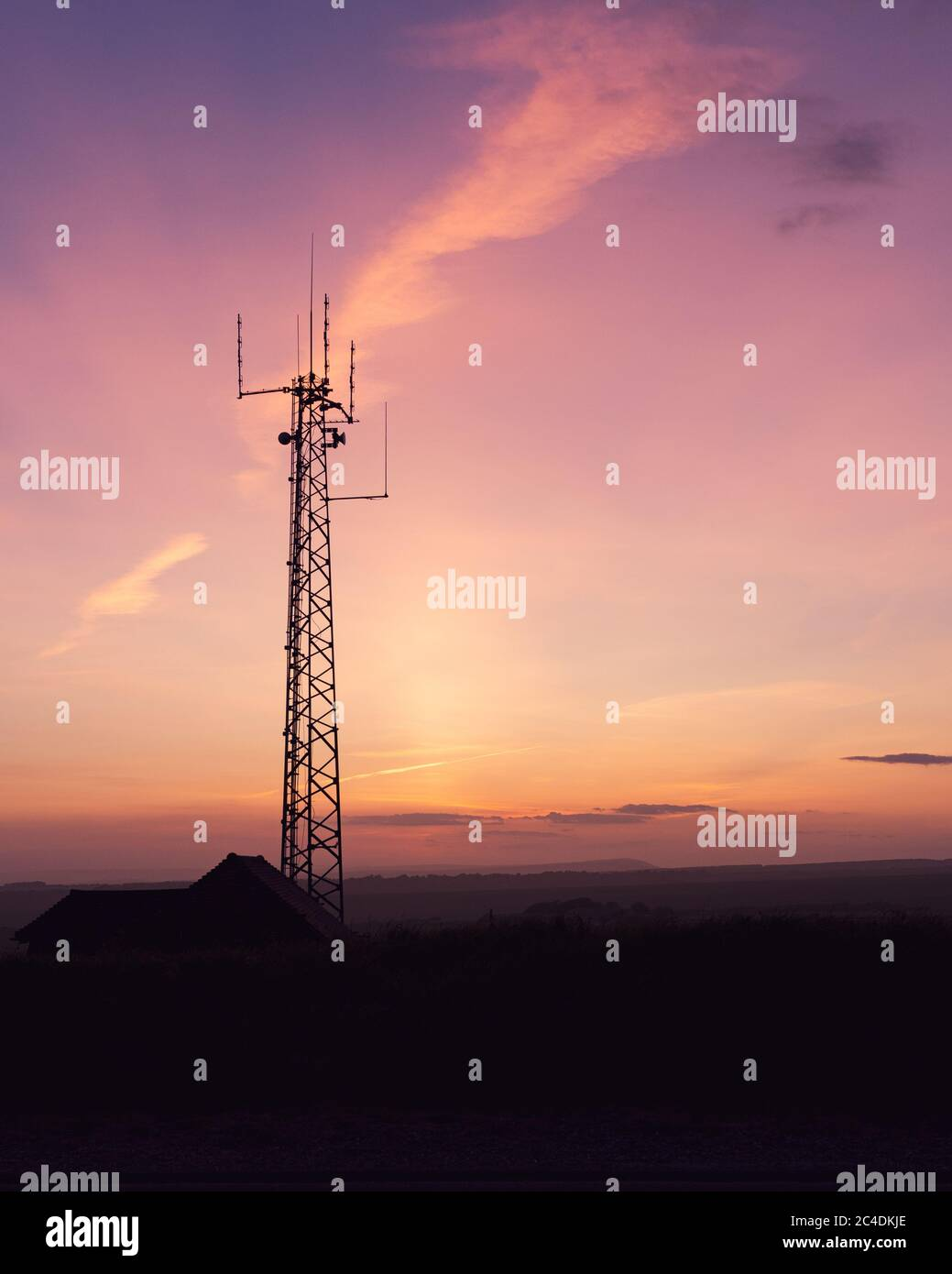 Vertical Shot Of A Telecom Tower In A Field Under The Breathtaking Sky Perfect For Wallpaper Stock Photo Alamy
